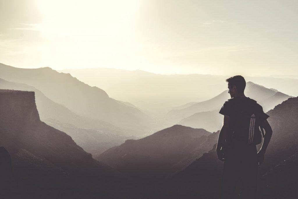 man looking over mist